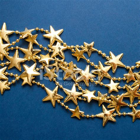gold christmas stars over blue background stock photos