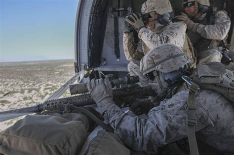 marine scout sniper fires on insurgents in iraq