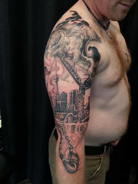 black and grey hawk tattoo 3 4 sleeve black and grey hawk toronto skyline and crane