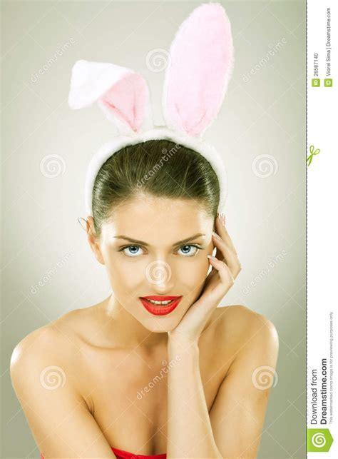 woman wearing hairstyle in dog ears smiling beautiful woman wearing bunny ears stock photo