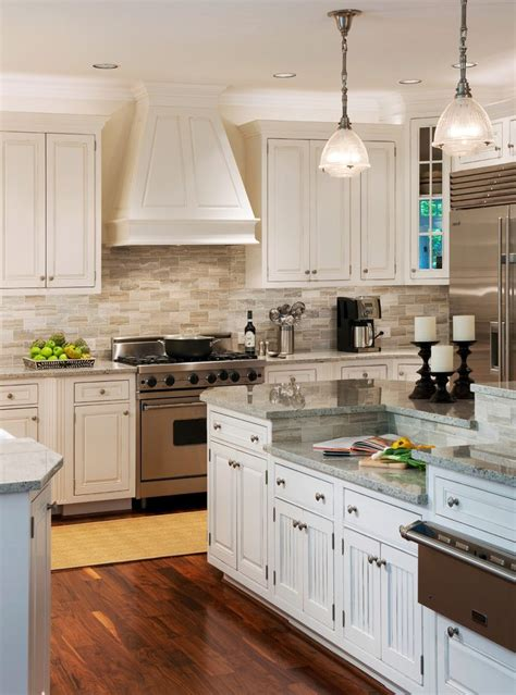 small white kitchen with steel hood dc metro travertine backsplash tile kitchen transitional
