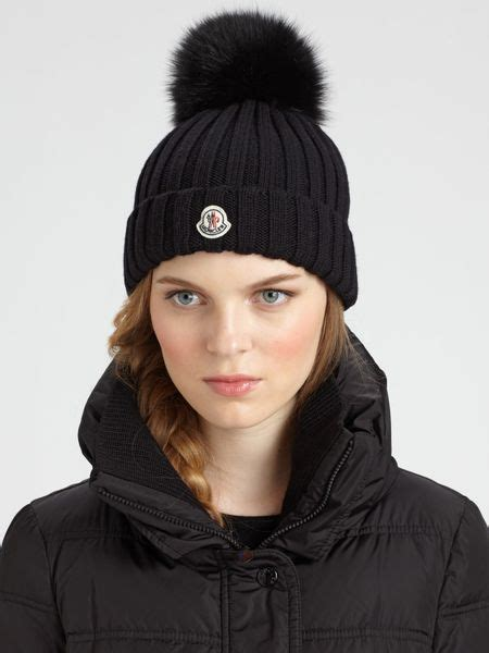 moncler fur pompom hat in black lyst