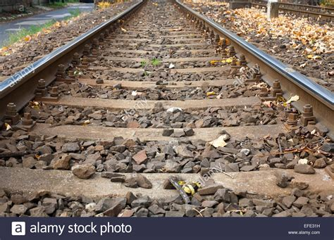 Railway Track Sleepers by Railway Track Background Rail And Concrete Sleepers