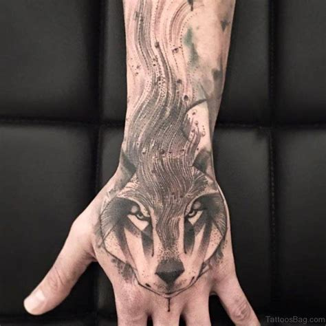 wolf hand tattoo 62 trendy wolf tattoos on