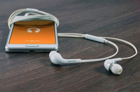 best earbuds smartphone smartphone and earphones earbuds free stock photo