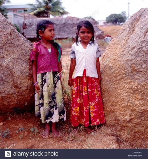 buy 2 houses next to each other two little indian girls standing next to each other in