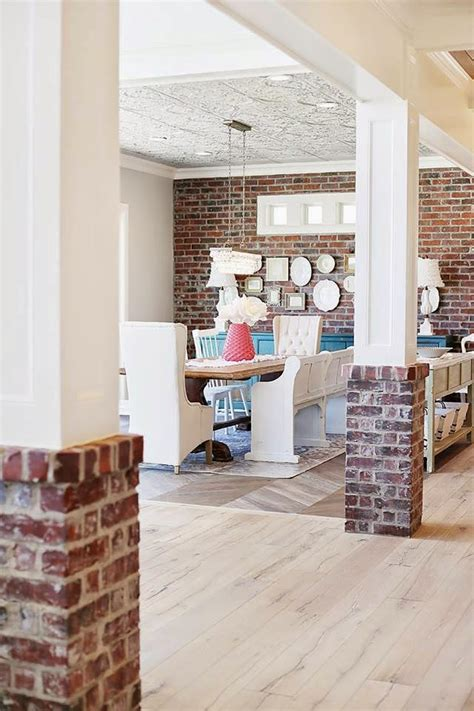 interior pillars with brick hearth and home