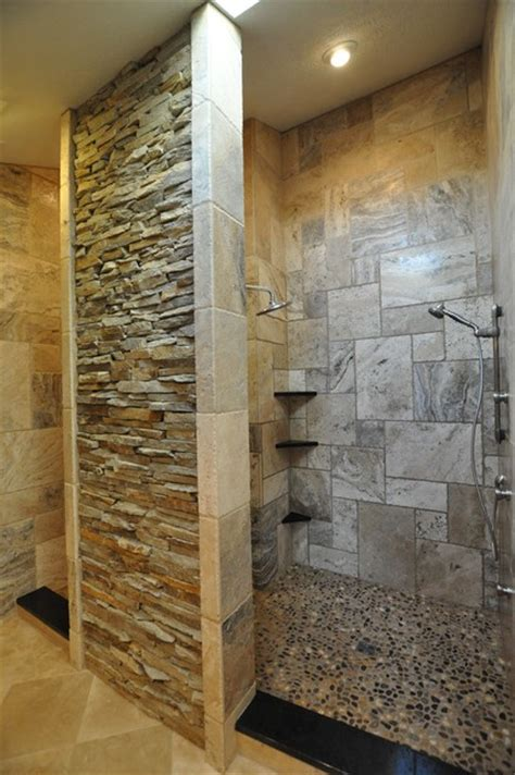 bathroom with stone bathrooms spas and stone tile showers traditional