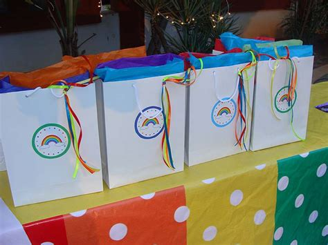 rainbow themed birthday return gifts rainbow theme stickered gift bags with ribbon untumble com