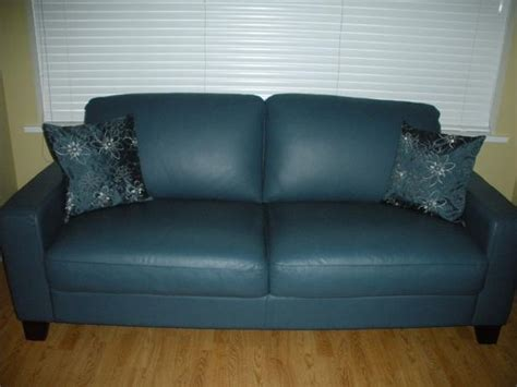 natuzzi leather sofa blue 76 inches w courtenay