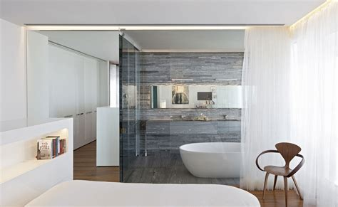 glass wall bathroom apartment with a reflective ceiling in tel aviv israel