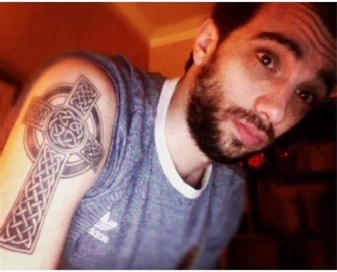 celebrity cross tattoos baruchel got tattooed by eric martinello at our