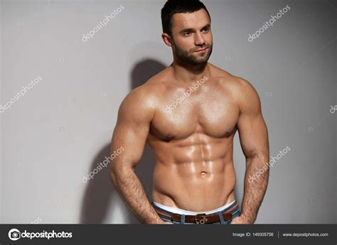 best stock photos of photo handsome man showing cell phone black handsome hot man with athletic body and sexy muscular body