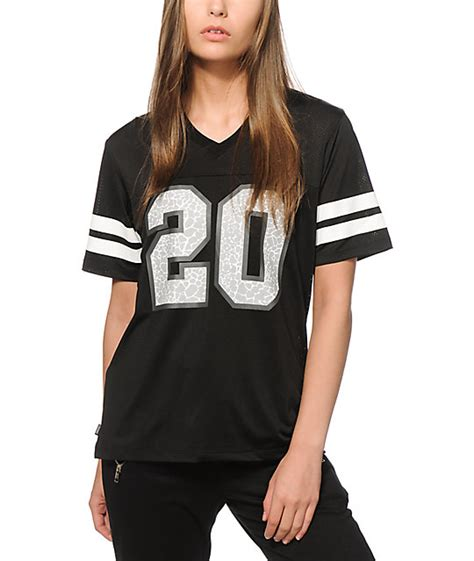 who is the lady in football jersey in viagra commercial crooks and castes lady crooks black mesh football jersey
