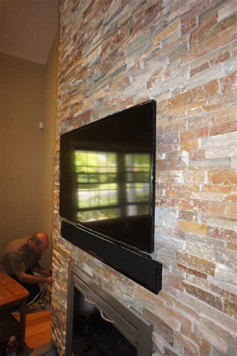 Led Tv Fireplace by Fireplace Led Tv Installation With Sound Bar On Brick