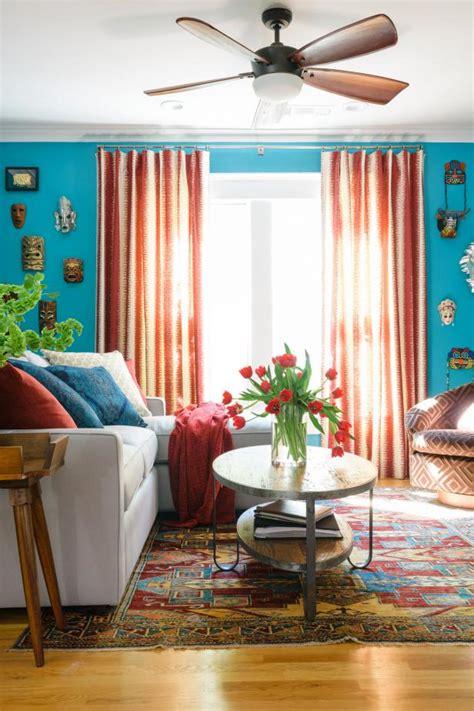 blue transitional family room  bronze ceiling fan hgtv