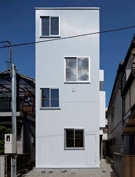 skinny house house in itami by tato architects sits on a narrow cul de sac