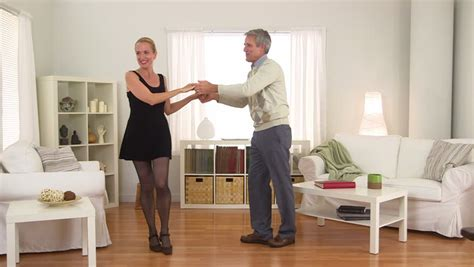 living room dancers senior in living room stock footage