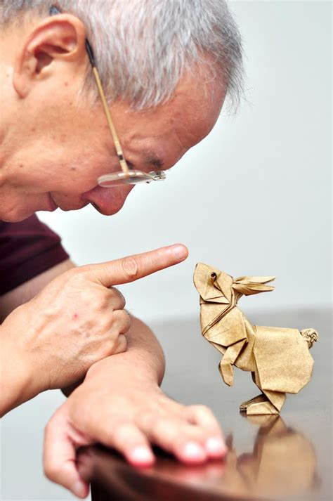 Origami Artist - surface to structure an origami exhibition featuring 80