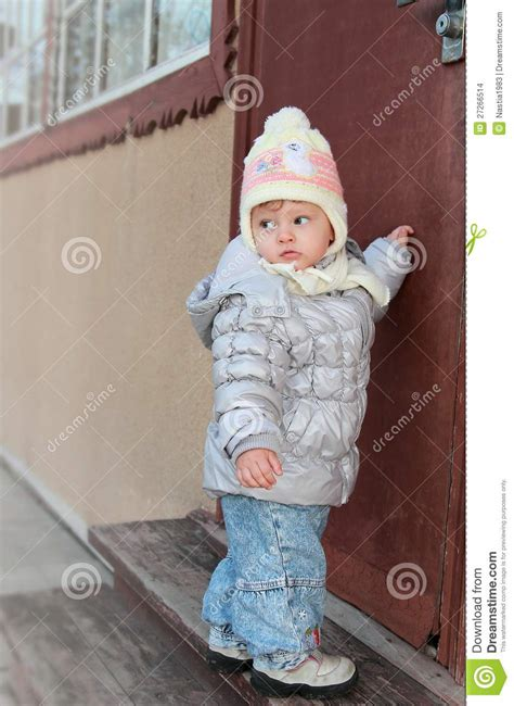 baby knocking at door of house stock images image