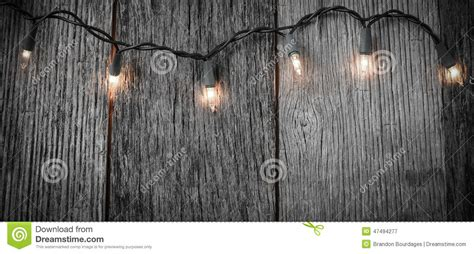 wood tree with lights white tree lights with rustic wood stock photo