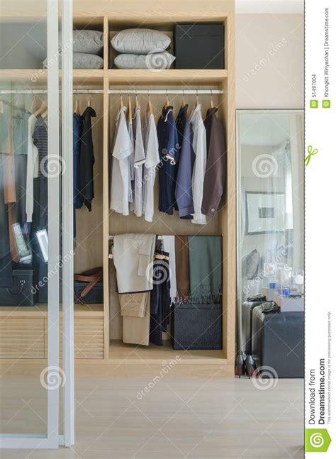 Wooden Wardrobes For Hanging Clothes Walk In Closet With Clothes Hanging In Wooden Wardrobe Stock Photo Image 51497004
