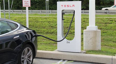 Tesla Car Charge Time Charged Evs Tesla S Liquid Cooled Supercharger Cable
