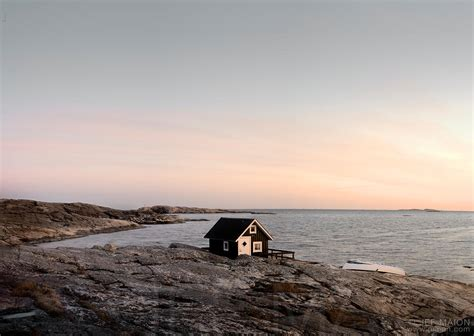 isolated house image isolated tiny house on rock by the sea stock photo by jf maion