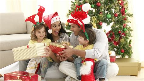 family opening christmas gifts at home footage in high