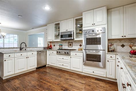 white kitchen cabinets with white appliances winda 7