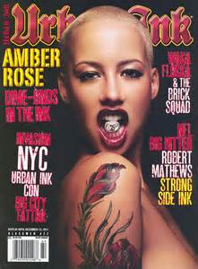 shaven headed amber rose reveals her tattoos in risque