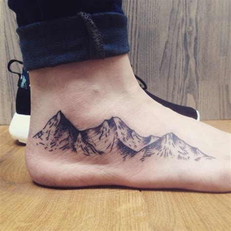 mountain tattoo on foot foot on
