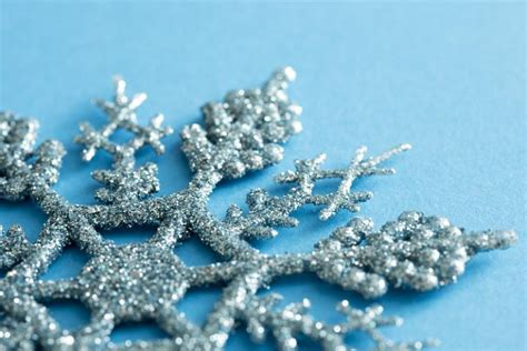 Blue Snowflakes Decorations by Photo Of Glitter Texture On A Blue Snowflake Decoration
