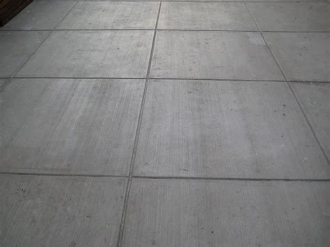 Garage Builders Near Me colored concrete slab with broom finish and colored