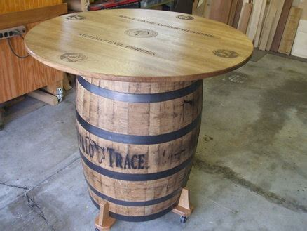 how to make a whiskey barrel table whiskey barrel table inspiration pinterest whiskey