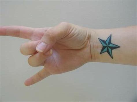 star tattoo meaning on wrist blue on wrist