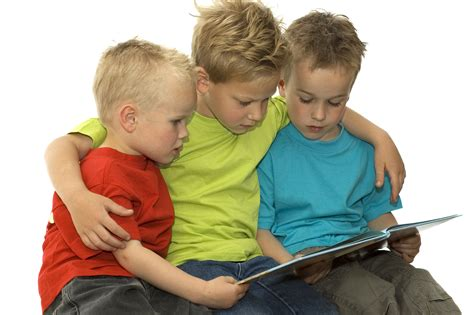 picture of children reading books three reading boys