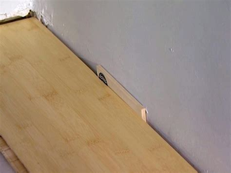 installing laminate flooring hgtv