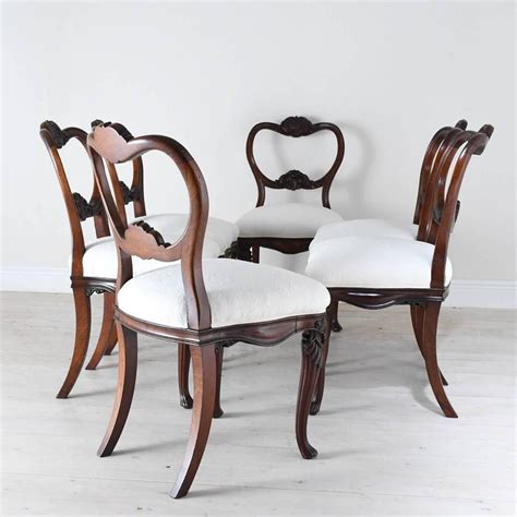 set of six flemish dining chairs with carved balloon back