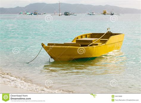 small yellow boat small yellow boat on blue tropical sea philippines