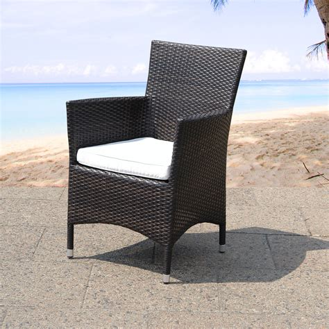 Single black wicker rattan dining chair with white linen fabric cushion pad of charming