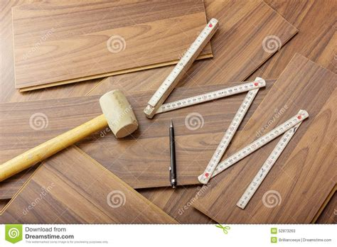 tools to laying laminate on the wooden floor stock photo image 52873263