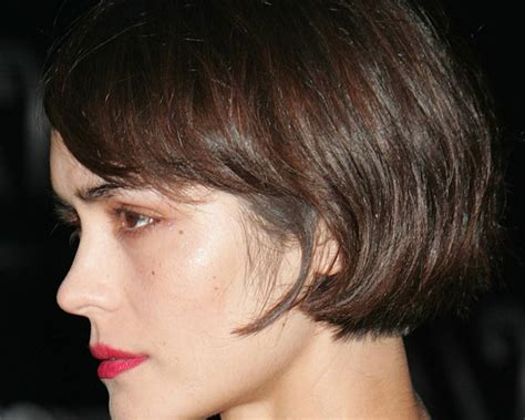 short bob haircut above the ear ear length symmetric bob haircut side swept bangs provides