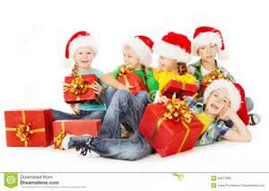 christmas helpers kids in santa hat holding presen royalty