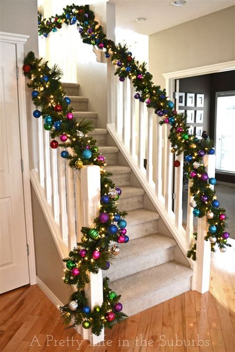 garland for stairs christmas staircase lighted garland and ornaments i want to do this but above my kitchen