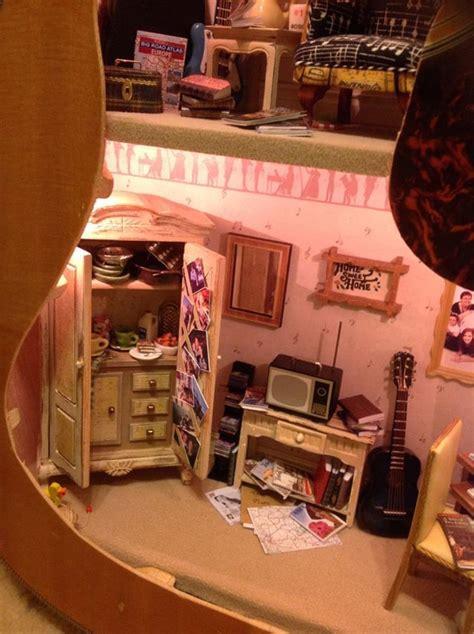 doll houses inside miniature dollhouse built inside an acoustic guitar
