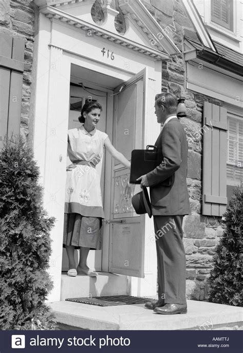 1950s salesman at door talking to stock photo