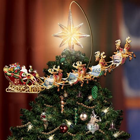rotating christmas tree topper the kinkade revolving tree topper hammacher schlemmer