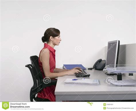 Office Worker At Desk Office Worker Using Computer At Desk Stock Image Image 31831551