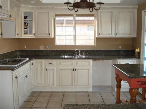 kitchen and bath cabinets vanities home decor design ideas - Antiqued White Kitchen Cabinets